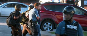 Huffington Post reporter Ryan J. Reilly is arrested when police officers suddenly closed a Ferguson McDonald's restaurant on West Florissant Avenue on Wednesday, Aug. 13, 2014. Photo by Robert Cohen, rcohen@post-dispatch.com